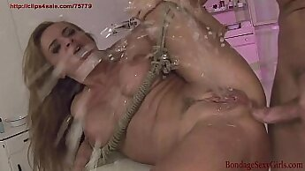 Bondage slut squirts on top of the bed with a gyno tool