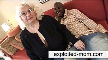 Chesty British granny sucking and fucking black cock